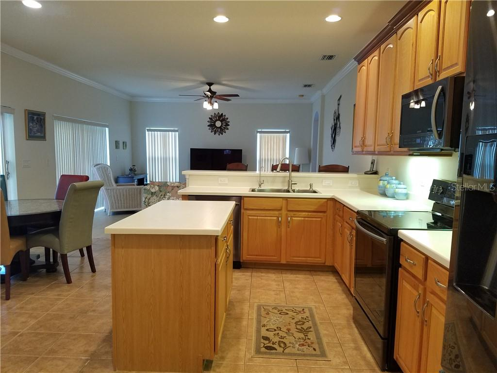 Watch TV or visit with friends and family while preparing your meals. - Single Family Home for sale at 2752 Suncoast Lakes Blvd, Punta Gorda, FL 33980 - MLS Number is C7402671