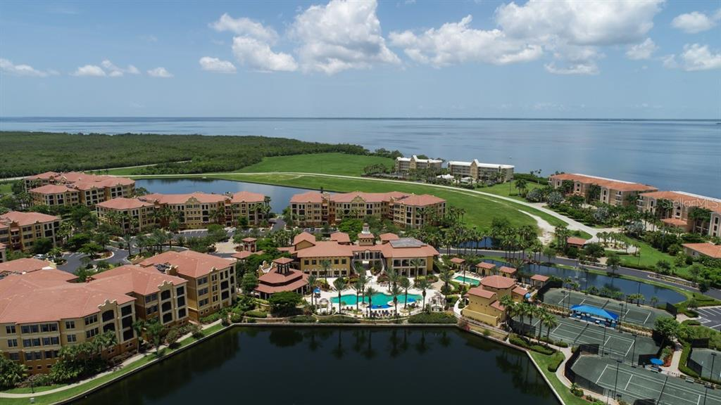 Real aerial of the fabulous 3 building clubhouse, pool, and tennis courts - Condo for sale at 95 Vivante Blvd #303, Punta Gorda, FL 33950 - MLS Number is C7402746