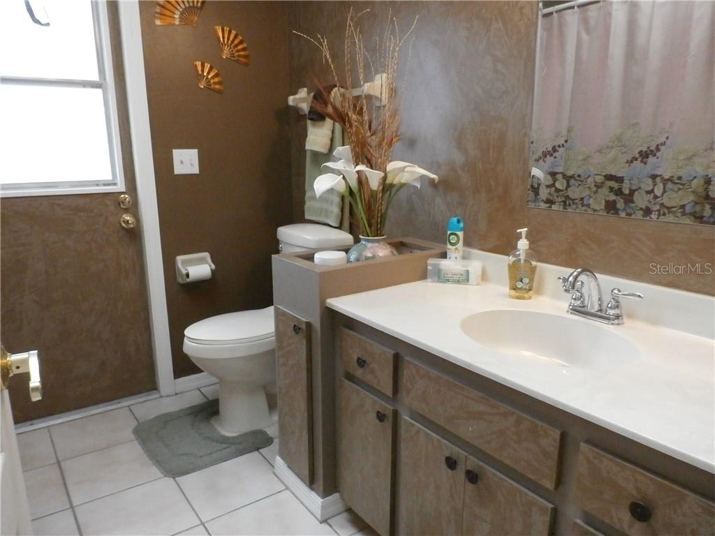 Guest bath with separate entry to pool and lanai - Single Family Home for sale at 416 Bahia Grande Ave, Punta Gorda, FL 33983 - MLS Number is C7408301