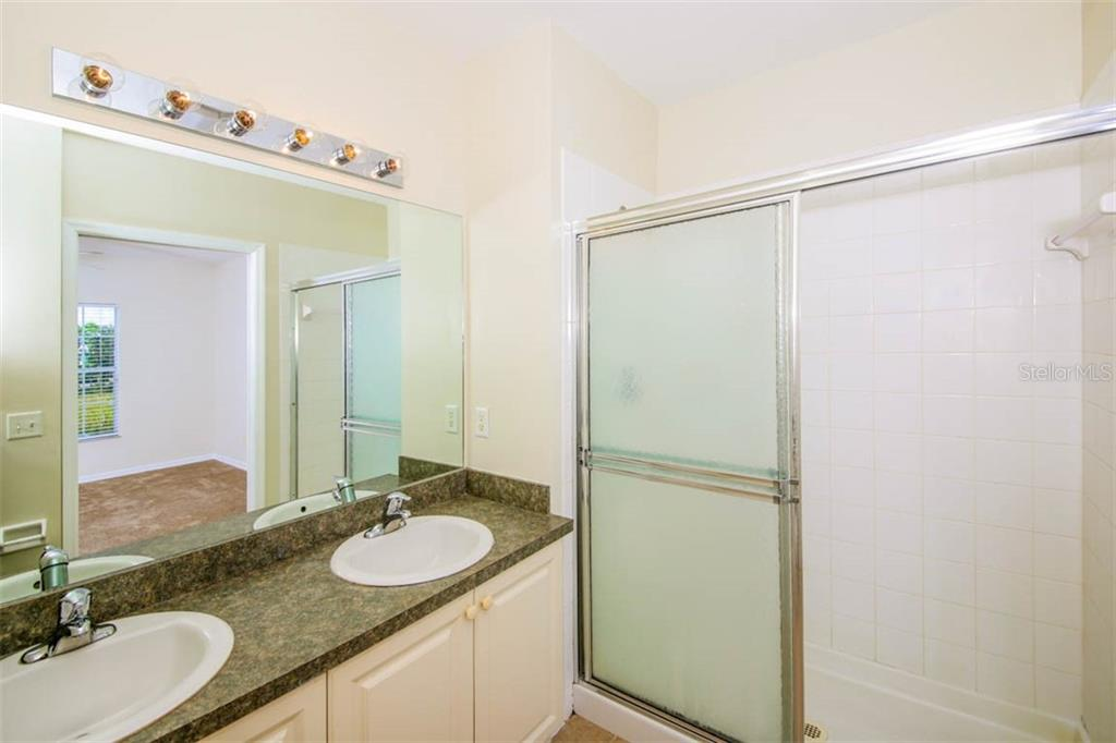 Master Bath has double vanity bowls & shower. - Condo for sale at 2040 Willow Hammock Cir #b208, Punta Gorda, FL 33983 - MLS Number is C7408424