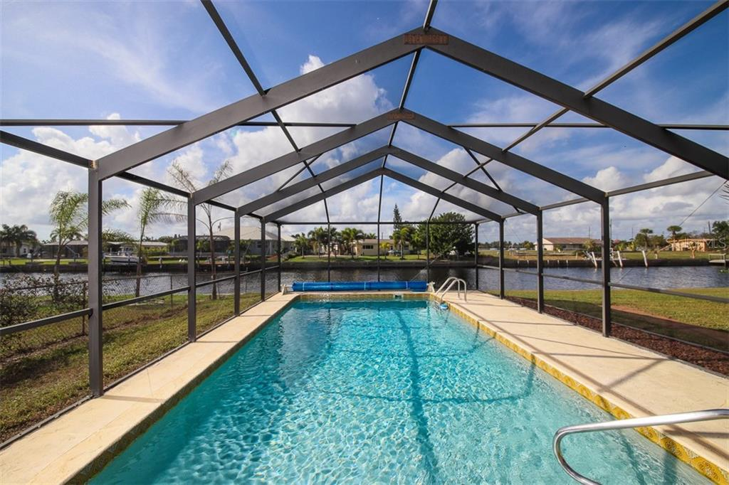 Ready for a dip after a fun-packed day on the water? - Single Family Home for sale at 126 Bangsberg Rd Se, Port Charlotte, FL 33952 - MLS Number is C7409866