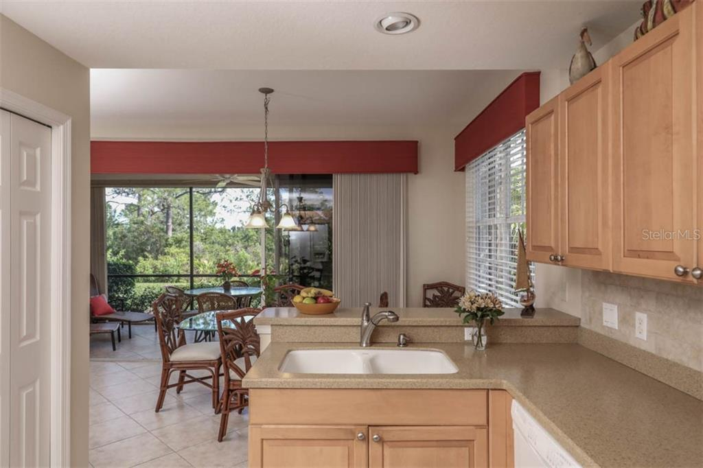 View from kitchen to beautiful outdoors - Condo for sale at 4643 Club Dr #102, Port Charlotte, FL 33953 - MLS Number is C7413207