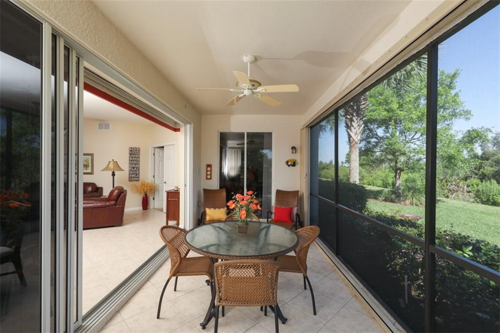 Tiled lanai with accordian hurrican shutters - Condo for sale at 4643 Club Dr #102, Port Charlotte, FL 33953 - MLS Number is C7413207