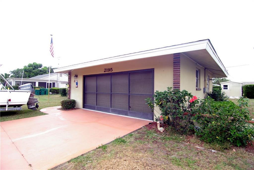 garage and screened doors - Single Family Home for sale at 2195 Abscott St, Port Charlotte, FL 33952 - MLS Number is C7414291