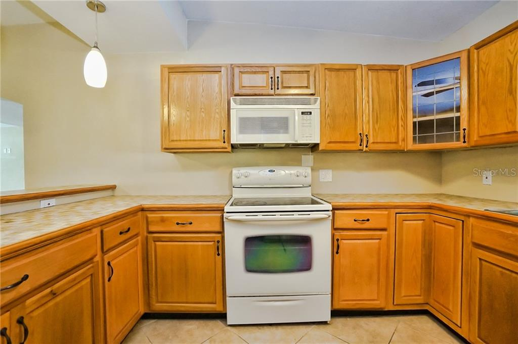 Kitchen - Plenty of Cabinets and Counter Space - Single Family Home for sale at 3513 Areca St, Punta Gorda, FL 33950 - MLS Number is C7414620