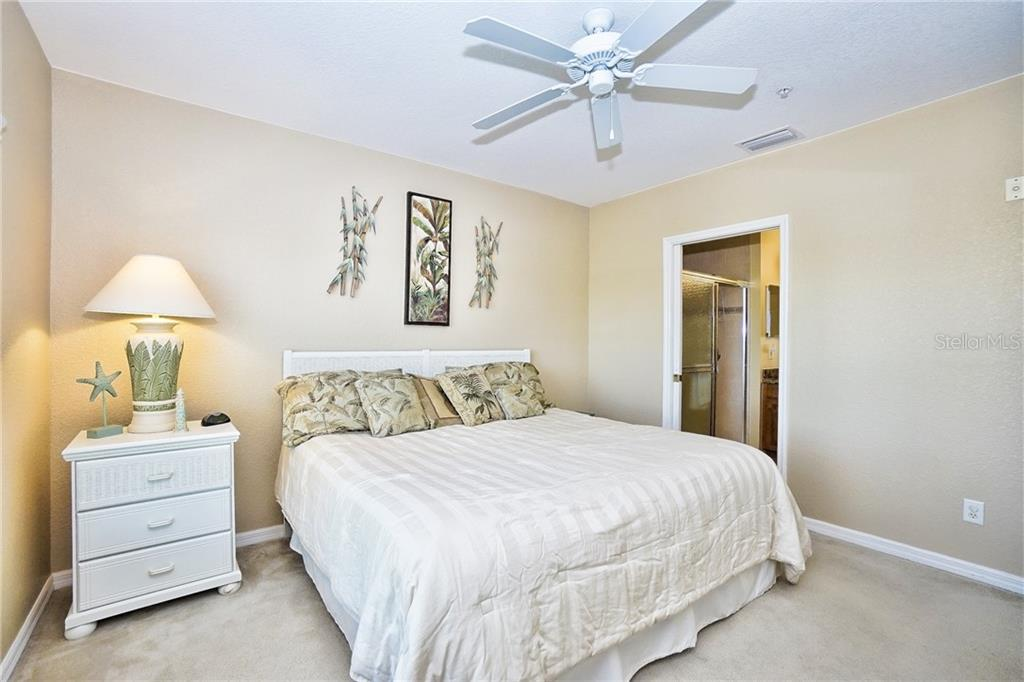 Master bedroom with entry to master bath - Condo for sale at 8405 Placida Rd #401, Placida, FL 33946 - MLS Number is C7414726