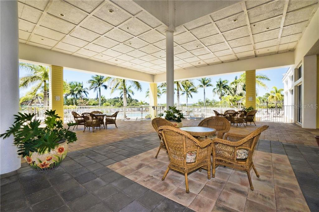 Veranda at community complex overlooking pool area - Condo for sale at 8405 Placida Rd #401, Placida, FL 33946 - MLS Number is C7414726