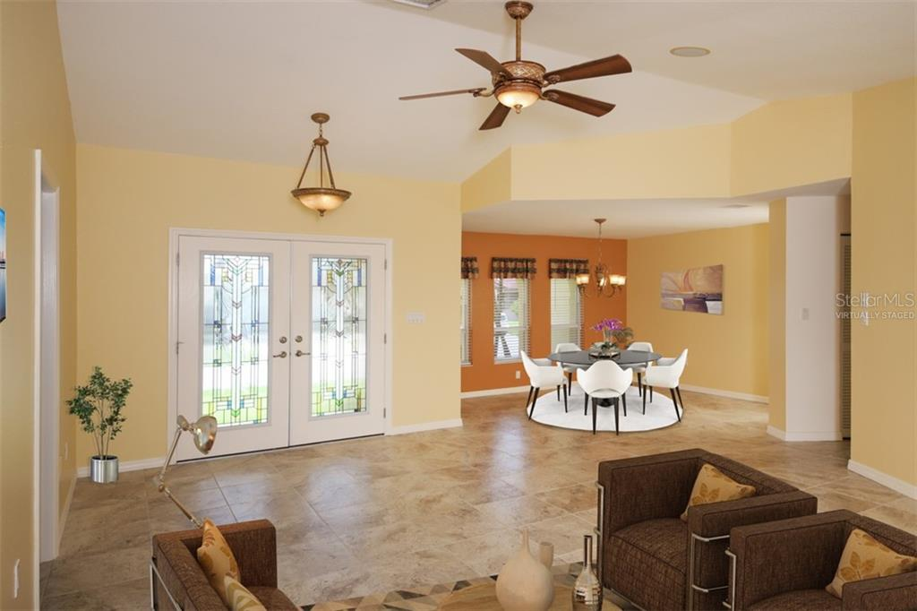 Family Room toward Kitchen, entry & Lanai - Single Family Home for sale at 2713 Saint Thomas Dr, Punta Gorda, FL 33950 - MLS Number is C7417491