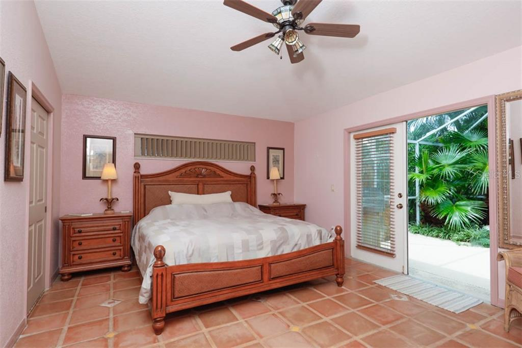 Master Suite enjoys french doors to the pool deck, generous walk-in closet, and private bath. - Single Family Home for sale at 1633 Islamorada Blvd, Punta Gorda, FL 33955 - MLS Number is C7418555