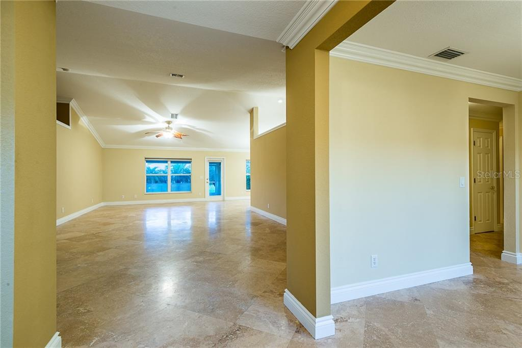 Travertine Tiles - Single Family Home for sale at 2440 Montpelier Rd, Punta Gorda, FL 33983 - MLS Number is C7421011