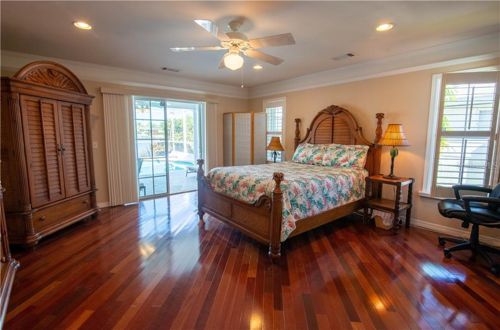 Master bedroom features sliders that open to the lanai and pool area. Note the plantation shutters which also open to expose full windows. - Single Family Home for sale at 1440 Appian Dr, Punta Gorda, FL 33950 - MLS Number is C7425399