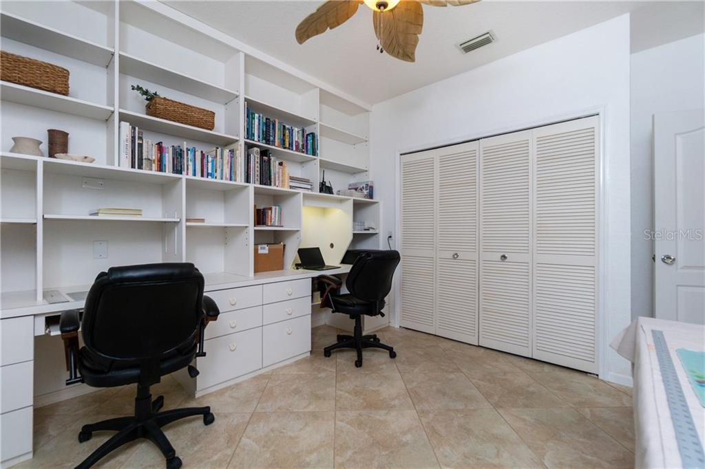 HOME OFFICE WITH BUILT IN DOUBLE DESKS AND SHELVES OR 4TH BEDROOM - Single Family Home for sale at 3537 Caya Largo Ct, Punta Gorda, FL 33950 - MLS Number is C7431664