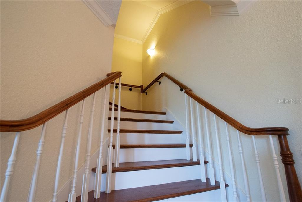 This beautiful wide staircase leads you from the first level to the second level where you will find the three generous ensuite bedrooms, each with their own walk-in closet and private balconies. - Condo for sale at 4410 Warren Ave #511, Port Charlotte, FL 33953 - MLS Number is C7432222