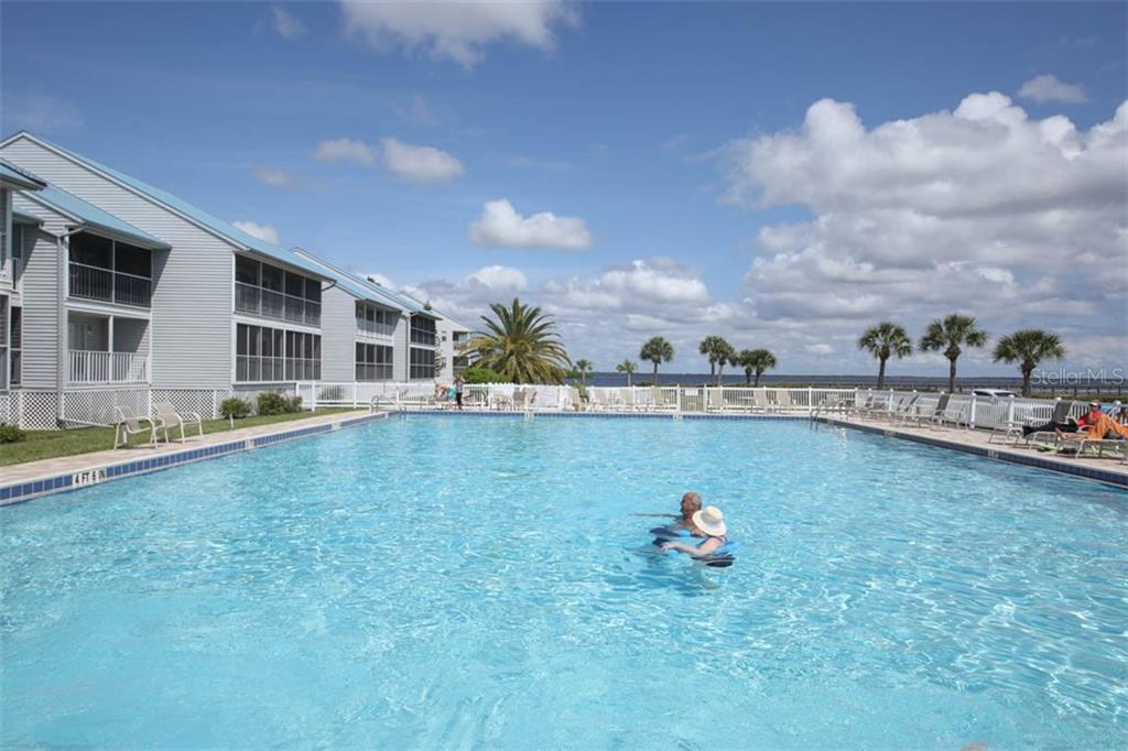 Enjoy the Olympic-sized heated pool and sun deck. - Condo for sale at 4410 Warren Ave #511, Port Charlotte, FL 33953 - MLS Number is C7432222