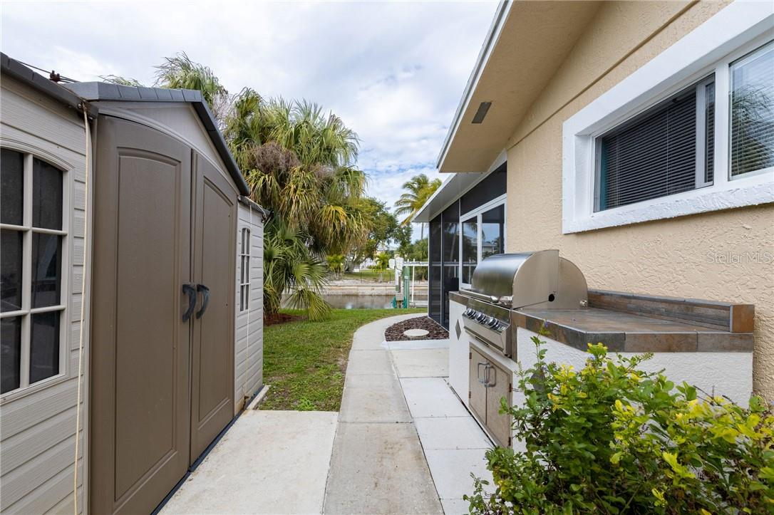 Plenty of outside storage. Outside gas grill with stone counter food prep space. - Single Family Home for sale at 24368 Blackbeard Blvd, Punta Gorda, FL 33955 - MLS Number is C7436898