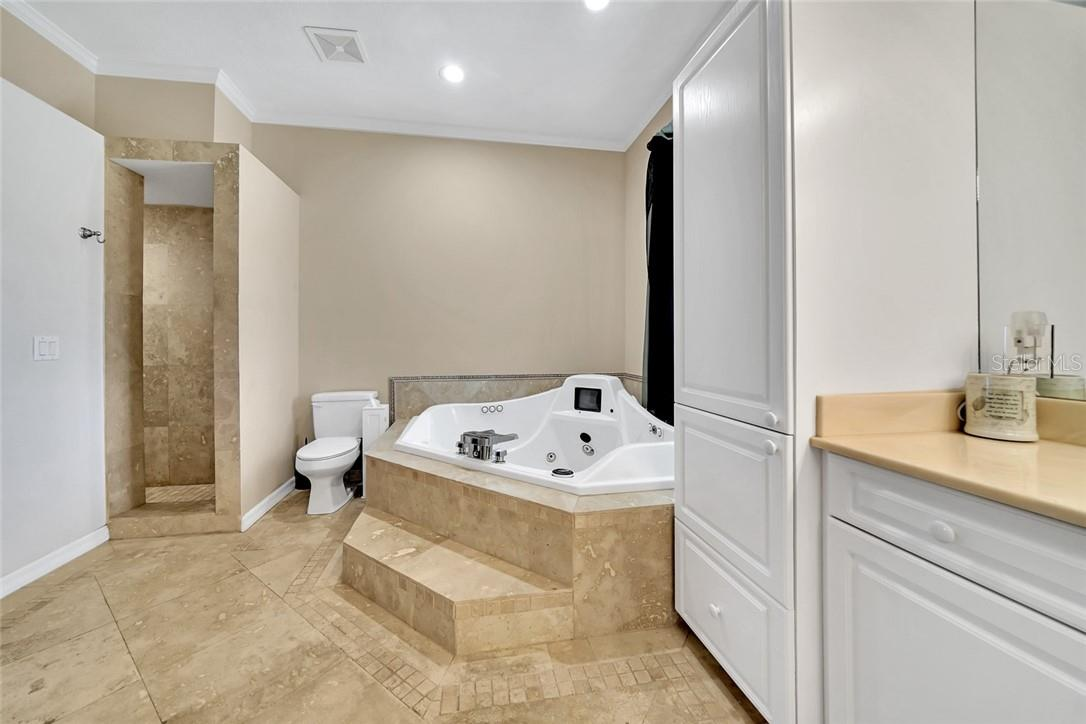 Master bathroom, travertine floors, walk in shower with multiple shower heads - Single Family Home for sale at 10230 Sw County Road 769, Arcadia, FL 34269 - MLS Number is C7437596