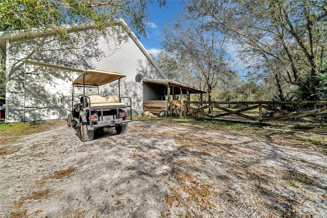 4 overhead doors, 1 - 10', 2 - 8' and 1 RV door at 14' - Single Family Home for sale at 10230 Sw County Road 769, Arcadia, FL 34269 - MLS Number is C7437596