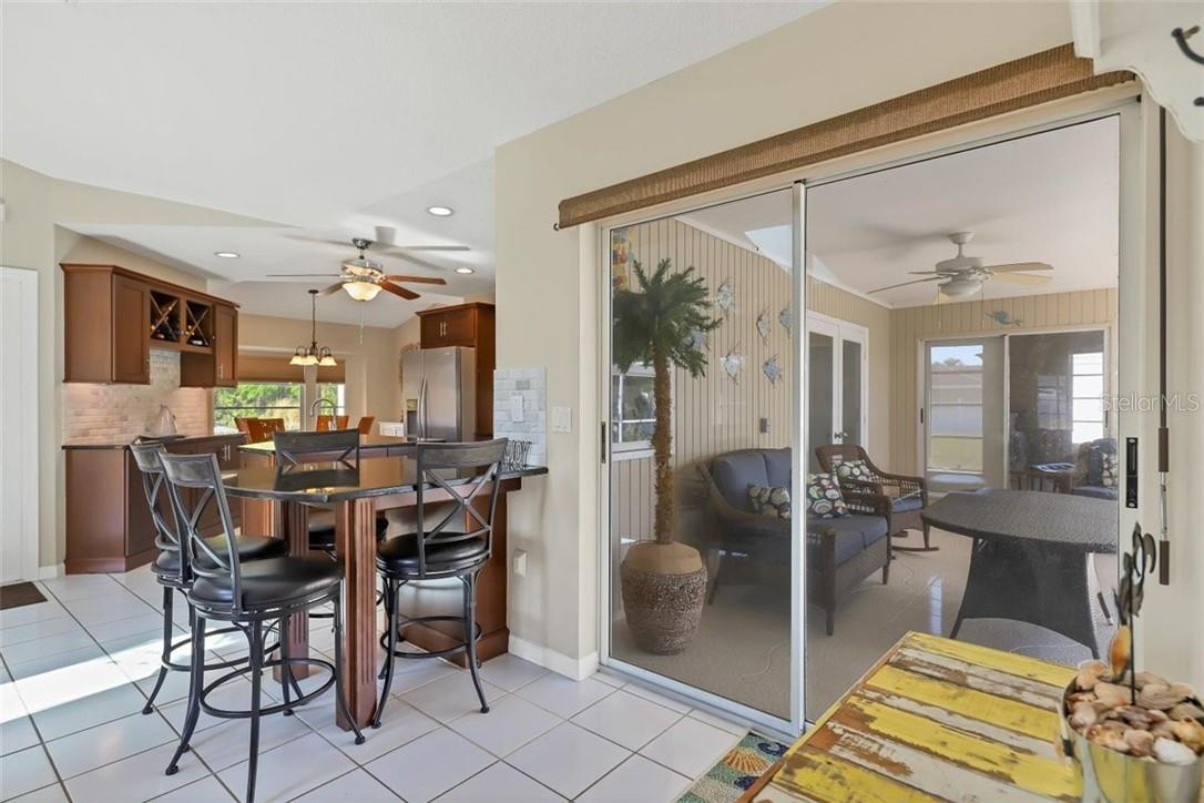 breakfast bar seating and if you'd like area in front of sliders is perfect for small bistro table - Single Family Home for sale at 116 Mariner Ln, Rotonda West, FL 33947 - MLS Number is C7441260