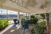 Watch tennis players at the Isles Yacht Club from this sitting area downstairs - Condo for sale at 1765 Jamaica Way #302, Punta Gorda, FL 33950 - MLS Number is C7234643