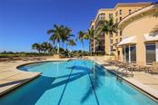Inviting heated pool with a nice combination of chaise lounges and patio tables.  Makes you want to take a dip in the sparkling water! - Condo for sale at 3313 Sunset Key Cir #402, Punta Gorda, FL 33955 - MLS Number is C7236886