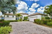 Inviting paver driveway with ample parking for your vehicles, while admiring your pristine landscape. - Single Family Home for sale at 2839 Mill Creek Rd, Port Charlotte, FL 33953 - MLS Number is C7238545