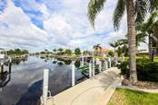 Cement dock with 10K boat lift - Single Family Home for sale at 1620 Appian Dr, Punta Gorda, FL 33950 - MLS Number is C7242315