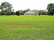 Back of lot faces South - Vacant Land for sale at 25478 Estrada Cir, Punta Gorda, FL 33955 - MLS Number is C7242940