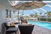 Relax by the pool - Single Family Home for sale at 2510 Rio Largo Ct, Punta Gorda, FL 33950 - MLS Number is C7246934