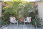 Front patio seating area. - Condo for sale at 6796 Gasparilla Pines Blvd #75, Englewood, FL 34224 - MLS Number is C7251454