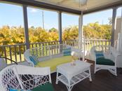 Screened porch with wooded view to the rear - Manufactured Home for sale at 11 Holland Ave, Punta Gorda, FL 33950 - MLS Number is C7401035