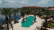 Pool overlooks a large lake - Condo for sale at 95 Vivante Blvd #303, Punta Gorda, FL 33950 - MLS Number is C7402746