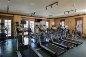 Huge fitness center in building 2 that overlooks the pool - Condo for sale at 95 Vivante Blvd #303, Punta Gorda, FL 33950 - MLS Number is C7402746