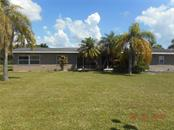 Single Family Home for sale at 3701 Wisteria Pl, Punta Gorda, FL 33950 - MLS Number is C7403796
