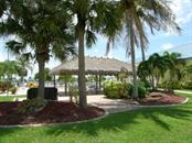 Luau at the Tiki Hut! - Manufactured Home for sale at 66 Windmill Blvd, Punta Gorda, FL 33950 - MLS Number is C7405183