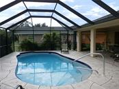 Complete pool view - Single Family Home for sale at 416 Bahia Grande Ave, Punta Gorda, FL 33983 - MLS Number is C7408301
