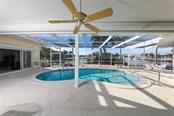 Pool with Owner Suite to the left. - Single Family Home for sale at 2291 Bayview Rd, Punta Gorda, FL 33950 - MLS Number is C7409445