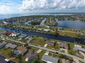Unique section of Port Charlotte called Buena Vista- all sailboat access community at the top of Charlotte Harbor - Single Family Home for sale at 126 Bangsberg Rd Se, Port Charlotte, FL 33952 - MLS Number is C7409866