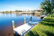 80-foot of waterfront and wide basin provide perfect accomodations for a large boat. Intersecting canal basin allows easy manuevering for your boating adventures. - Single Family Home for sale at 1440 Appian Dr, Punta Gorda, FL 33950 - MLS Number is C7425399