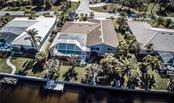 Overhead view of back of home and boat dock. - Single Family Home for sale at 1440 Appian Dr, Punta Gorda, FL 33950 - MLS Number is C7425399