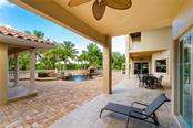 Under an expansive covered Lanai guests can enjoy the fresh Florida air, or step out for a relaxing swim - Single Family Home for sale at 7440 Riverside Dr, Punta Gorda, FL 33982 - MLS Number is C7436263