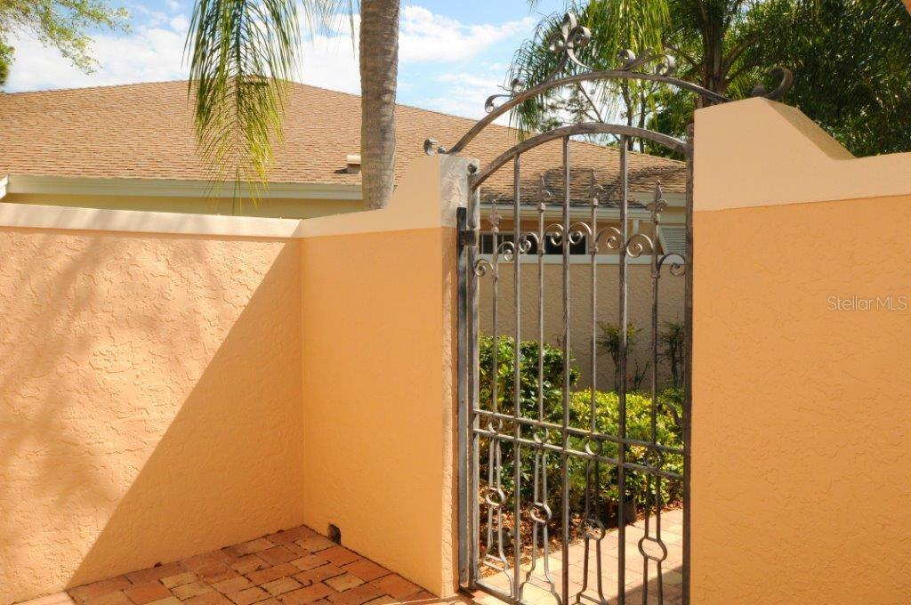 Entrance gate to front entry - Villa for sale at 5510 Chanteclaire #46, Sarasota, FL 34235 - MLS Number is A4156527