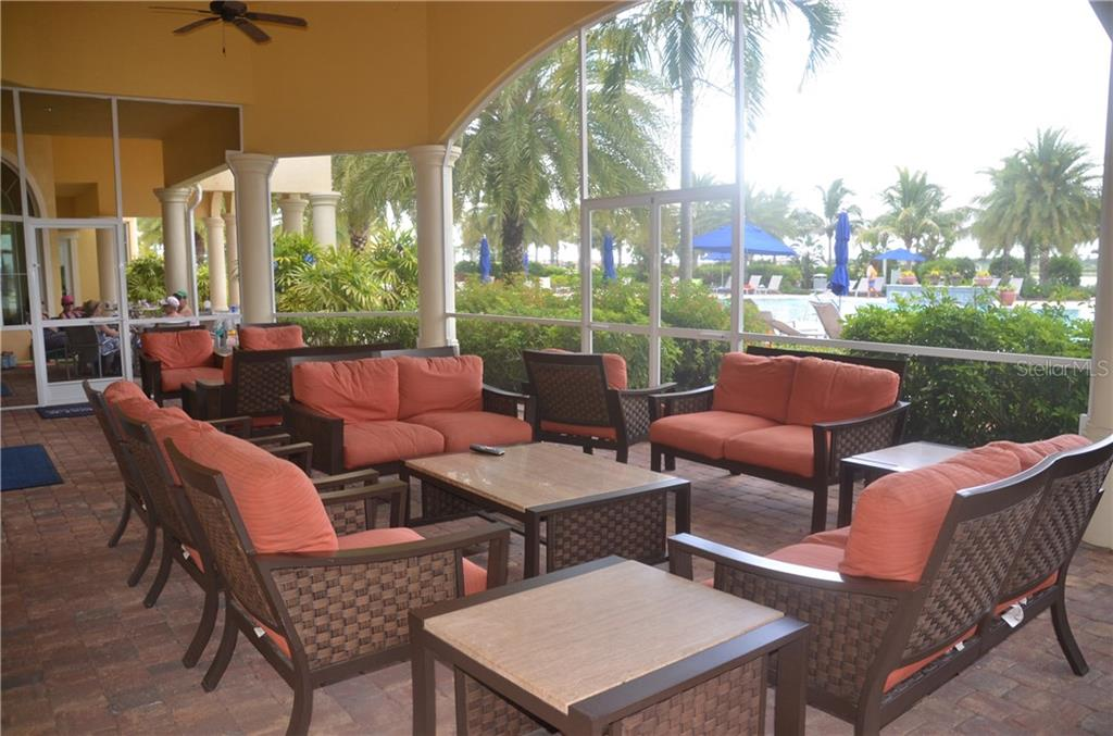 An example of one of the outdoor seating areas for residents to enjoy. This one is covered and screened, overlooking the pool. - Single Family Home for sale at 13328 Coluccio St, Venice, FL 34293 - MLS Number is A4160649
