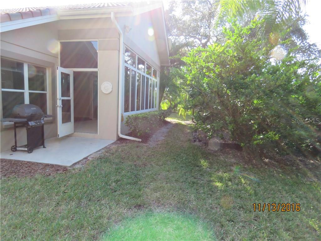 Rear entry with slab for another lanai, perfect for that evening barbecue. - Villa for sale at 4552 Deer Trail Blvd, Sarasota, FL 34238 - MLS Number is A4161593