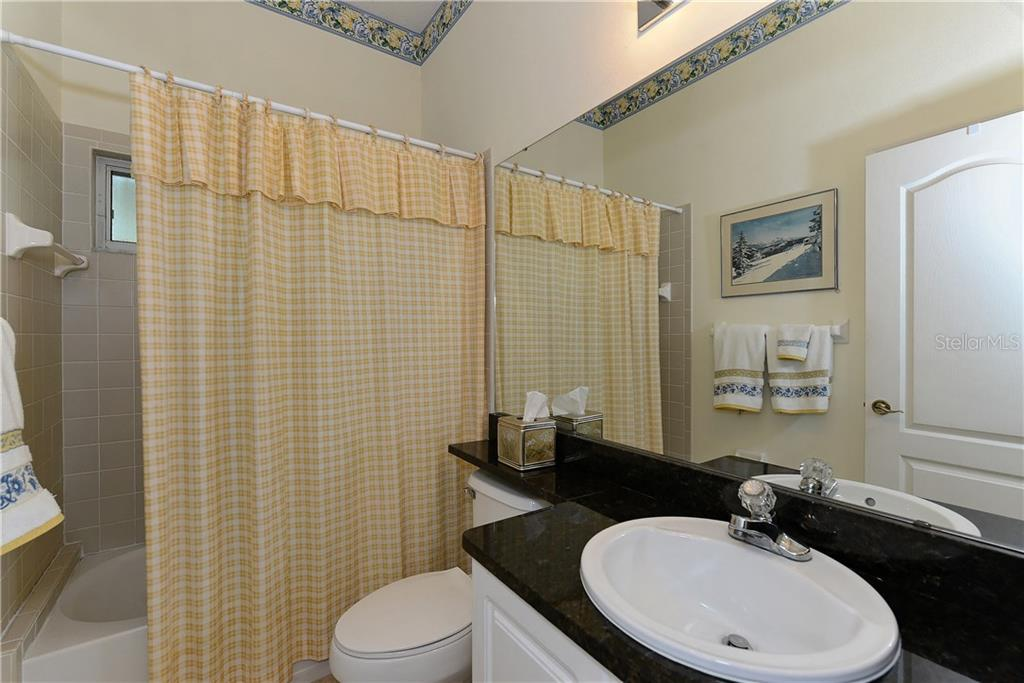 Full guest bath - this bath is centered between bedroom 2 & 3.  There's a well placed operable window over the shower area. - Single Family Home for sale at 8753 Merion Ave, Sarasota, FL 34238 - MLS Number is A4165409