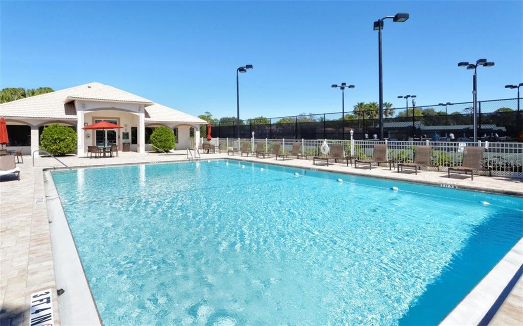 Stoneybrook Golf & Country Club heated pool and fitness center----lighted Har-Tru tennis courts to the right. - Condo for sale at 9630 Club South Cir #6103, Sarasota, FL 34238 - MLS Number is A4166105