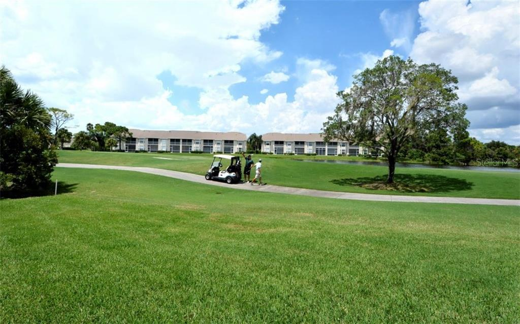 First floor end unit condo . View from just outside of lanai showcases the golf course and distant lake. - Condo for sale at 9630 Club South Cir #6103, Sarasota, FL 34238 - MLS Number is A4166105