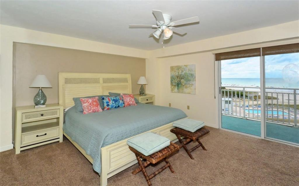 Master bedroom with sliders to open balcony - Single Family Home for sale at 5830 Midnight Pass Rd #504, Sarasota, FL 34242 - MLS Number is A4166623