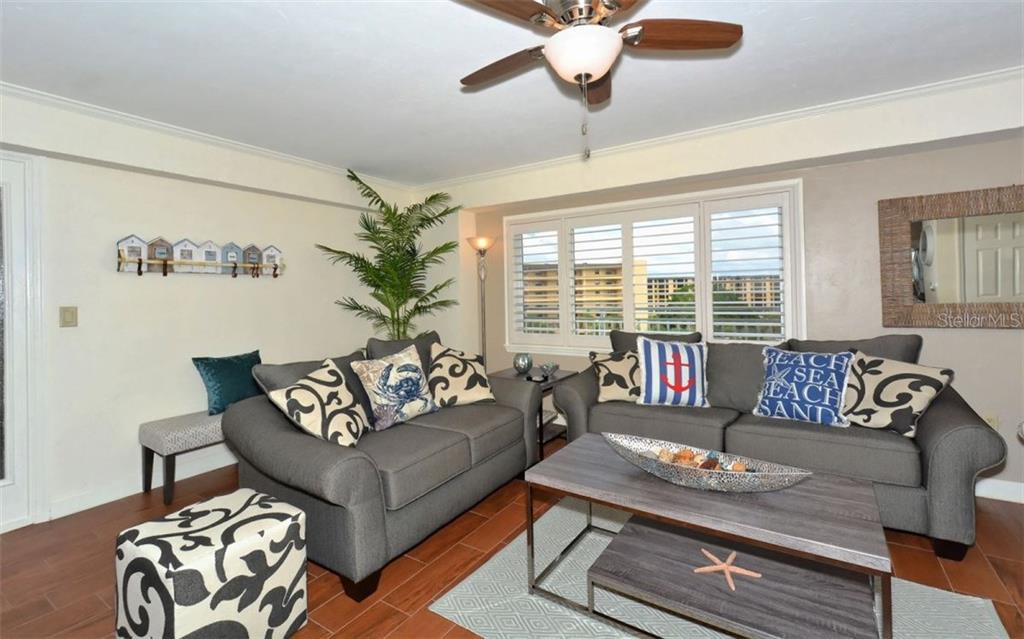 Living room - Single Family Home for sale at 5830 Midnight Pass Rd #504, Sarasota, FL 34242 - MLS Number is A4166623