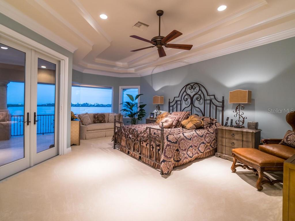 Master bedroom with French doors to terrace and gorgeous bay views - Single Family Home for sale at 640 Rountree Dr, Longboat Key, FL 34228 - MLS Number is A4169177