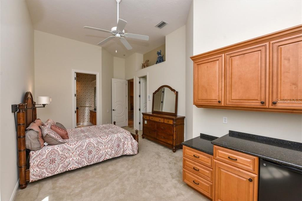 One of the secondary bedrooms has an outside entrance and small kitchen area; a perfect private suite set up. - Single Family Home for sale at 3313 Founders Club Dr, Sarasota, FL 34240 - MLS Number is A4169443